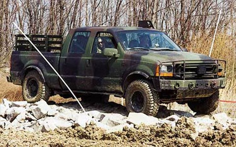 163_0112_lav_27z+1999_ford_f-350+front_side_view.jpg