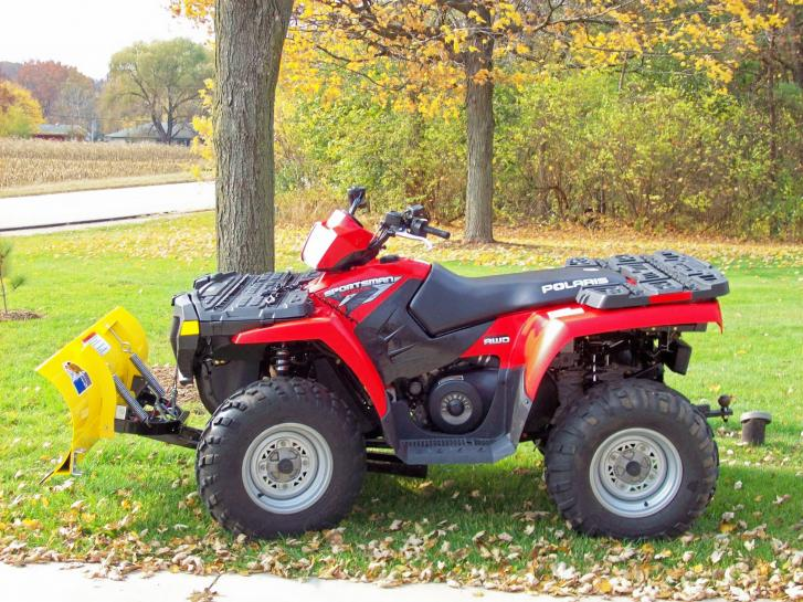 ATV with Plow side view.jpg