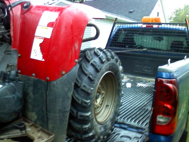 old quad winched on truck.jpg