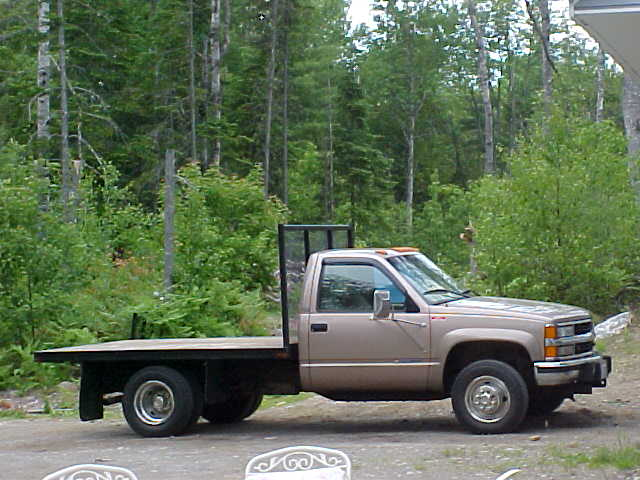 one ton \'96 chevy  - has 2 yard sander on flatbed in winter.jpg
