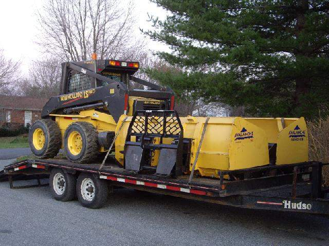 Skid Loader and Avalanche Plows on Trailer.jpg