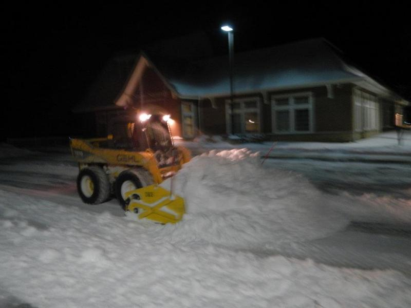 skid loader pushing snow.jpg