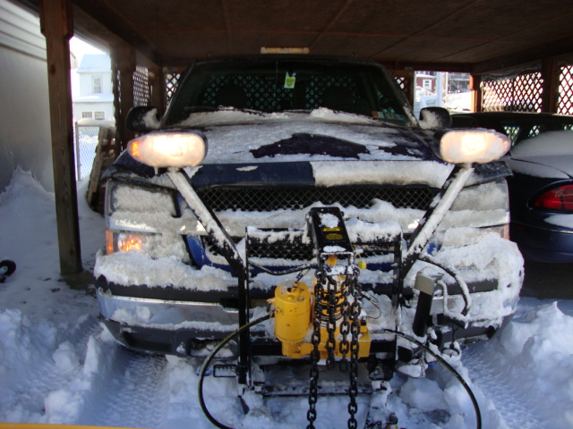 truck front end covered from plowing roads.JPG